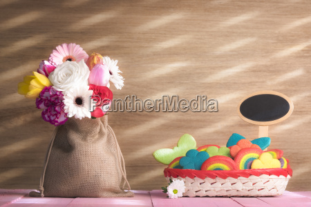 flowers and colorful cookies with a
