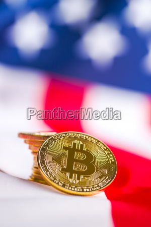 golden bitcoins cryptocurrency on usa flag