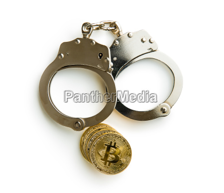 golden bitcoins cryptocurrency and hancuffs