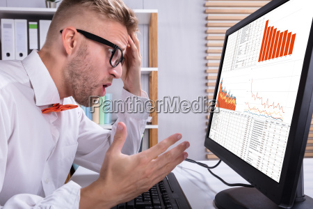 businessman looking at graph