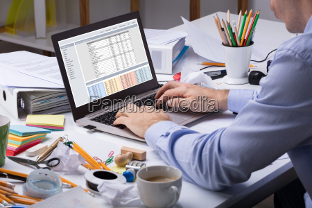 businessman using laptop at workplace