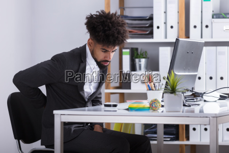 businessman suffering from back ache