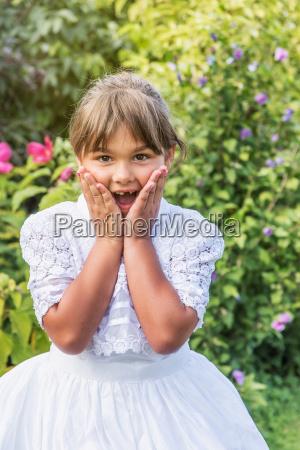 portrait of surprised little girl in