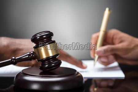 gavel in front of persons hand