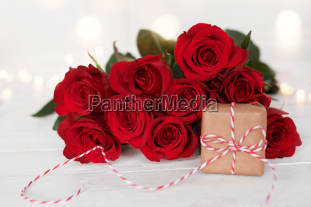 red roses with a gift for