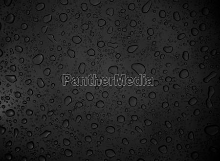 schwarzer hintergrund mit wassertropfen