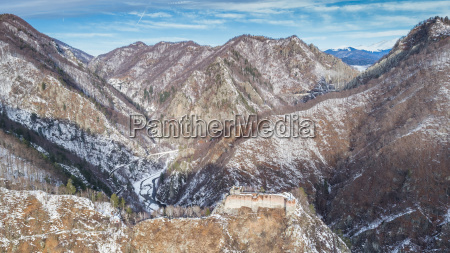 ruined poenari fortress in winter romania