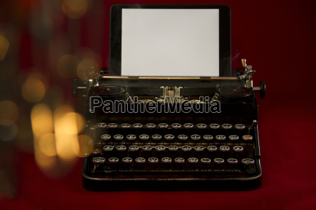 nostalgic typewriter with tablet