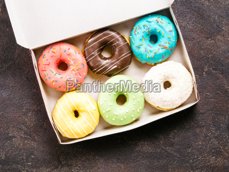 paper box with colorful donuts top