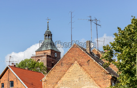roofs with tv antennas and church