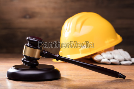 gavel in front of yellow safety
