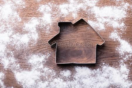 house cutter on wooden desk