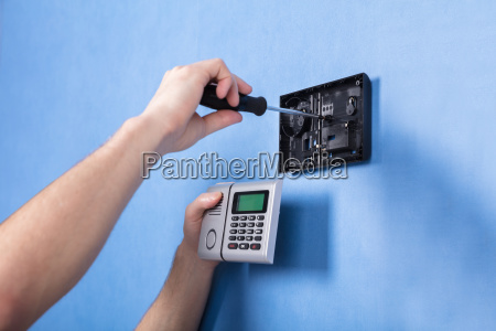 human hand installing security system