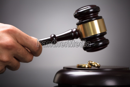 judge hitting gavel on golden rings