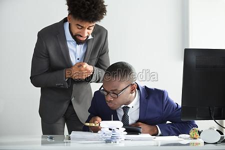 worried man looking at auditor analyzing