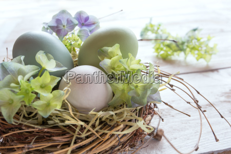 easter eggs decorated in a nest
