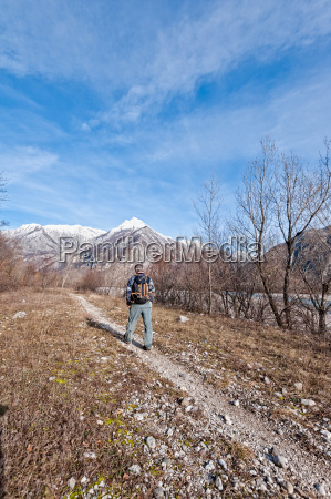 hiker walking on path toward the