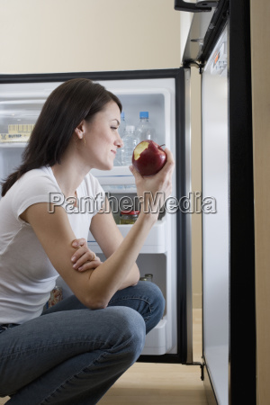 woman eating apple in front of