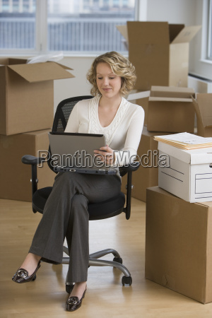 businesswoman working in new office