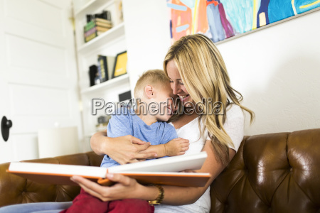 mother reading book to son 4