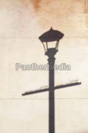 shadow of street lamp on wall
