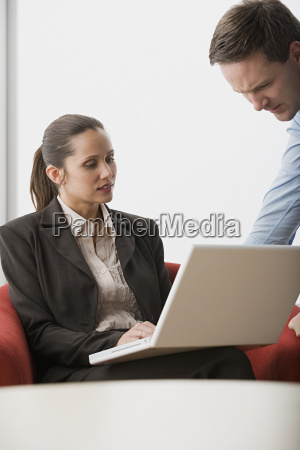 two business people with laptop in