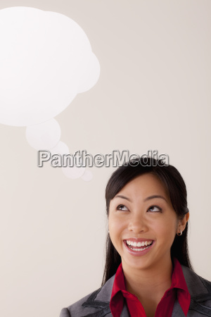 studio portrait of businesswoman with thought