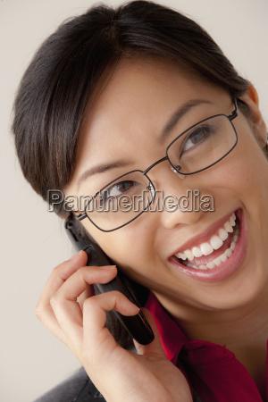studio portrait of businesswoman talking on