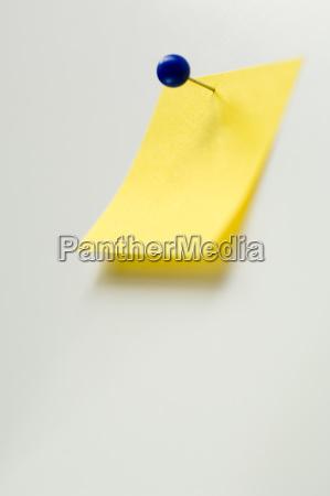 studio shot of yellow adhesive note