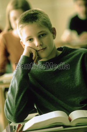 elementary school student sitting at his