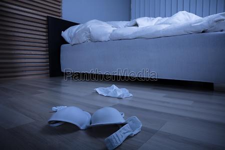 scattered lingerie in the bedroom