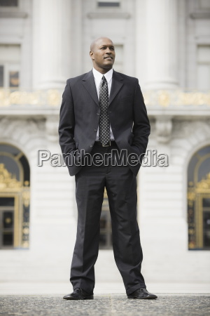 businessman standing outside office building san