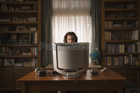 woman sitting at desk in home