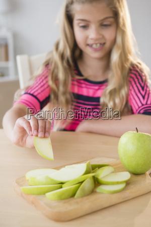 portrait of girl 8 9 eating