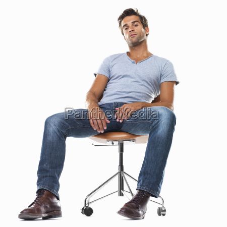 portrait of smart young man sitting