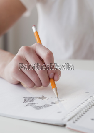 woman drawing recycling symbol
