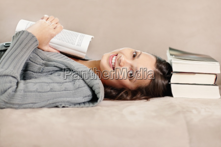 brunette woman relaxing and reading