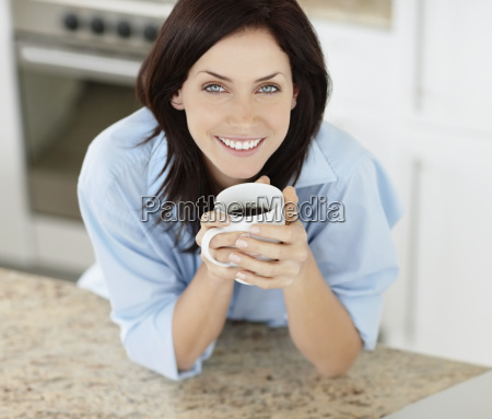 brunette woman drinking coffee