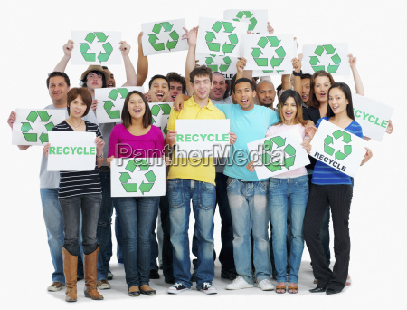 group of people holding recycle signs