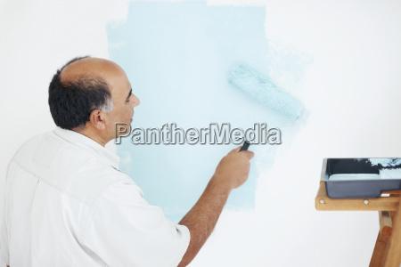 man painting wall