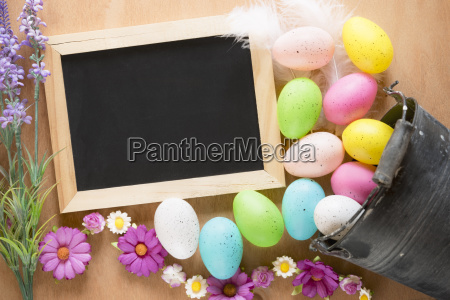 bucket with easter eggs and a