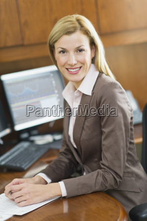 portrait of businesswoman sitting at desk