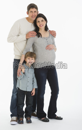 studio portrait of father pregnant mother