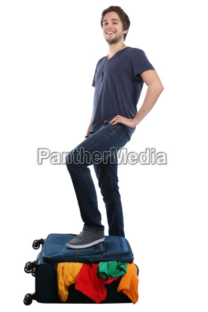 young man packing suitcase travel traveling