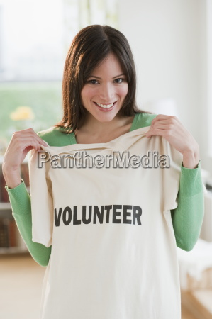 mid adult woman showing t shirt