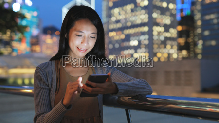 woman looking at mobile phone in