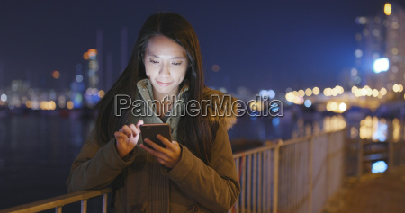 woman using cellphone in city