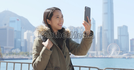 woman taking video call on cellphone