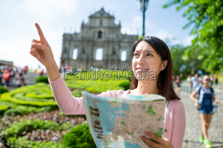 woman holding city map and finger