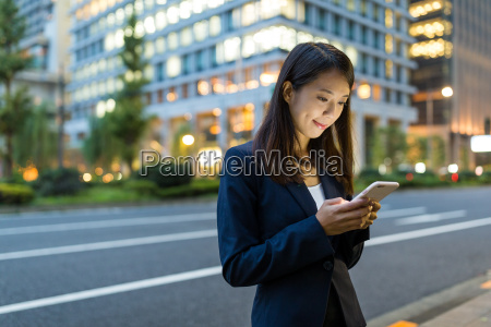 businesswoman working on mobile phone in